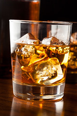 Golden Brown Whisky on the rocks (brent.hofacker) Tags: orange brown cold ice glass yellow gold golden amber rocks shot drink beverage hard scottish whiskey spirits cocktail liquor alcohol single cube blended whisky rum brandy scotch alcoholic bourbon cognac liquid malt