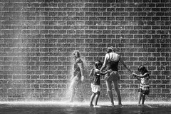 Cascade of water (dharder9475) Tags: city family summer people blackandwhite bw chicago water fountain walking downtown loop strangers photowalk millenniumpark highspeed stopped 2013