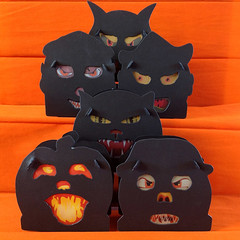 Creeps (Shadow Edition) (bindlegrim) Tags: orange holiday black halloween silhouette contrast festive weird artist glow faces crepe lanterns boxes limitededition vellum vintagestyle creeps candycontainer slotandtab