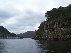 Shieldaig Island, West Coast of Scotland, May 2011, Explored (allanmaciver) Tags: trees west water clouds dark island grey coast scotland warm day view cloudy may cliffs shelter torridon shieldaig allanmaciver