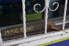 Music is rad (dogwelder) Tags: california dusty window leaves sign losangeles unitedstates securitybars