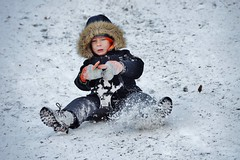 motion photography: a boy having fun sledding in central park ---------- viewed 428x (norlandcruz74) Tags: park new york city nyc boy snow ny day central sledding sled sledder vision:mountain=0617 vision:outdoor=0985 vision:snow=0673