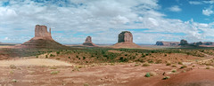 Monument Valley (flippers) Tags: vacation arizona usa mountain holiday mountains film rock america 35mm unitedstates desert horizon wide roadtrip panoramic threesisters swinglens navajo monumentvalley mittens thehub horizonperfekt oljatomonumentvalley istsébii'ndzisgaii