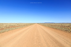 Road (john white photos) Tags: road red dusty desert 4x4 australian dry australia bluesky dirt trail outback remote straight southaustralia plain arid gravel flindersranges fourwheeldrive arkaroola
