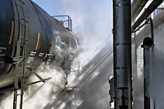 Sunlight through the steam (Chuck Wilson Photo) Tags: railroad light train shadows tank rail naturallight steam railcar transportation canoneos tanker tankcar tanktrain canonxti tankrail transloading