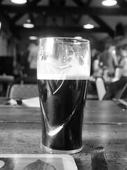 black stuff (Lamerie) Tags: blackandwhite beer glass monochrome beverage guinness porter stout glasshalffull glasshalfempty