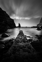 Portcoon Jetty, Antrim's Coast (Wojtek Piatek) Tags: longexposure ireland blackandwhite irish seascape clouds zeiss giant landscape mono big movement rocks angle jetty sony wide lee nd northernireland antrim a99