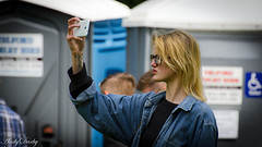 Portaloo Selfie (Andy Darby) Tags: woman girl hair glasses long pretty candid blond blonde pout portaloo selfie portalooselfie