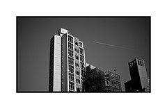 Contrail in NY Cityscape (Geoff Reno) Tags: street city nyc newyorkcity urban blackandwhite bw usa ny newyork cityscape fuji urbanlandscape x100t