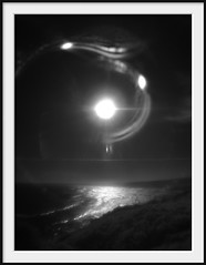 questionable (Andrew C Wallace) Tags: ocean blackandwhite bw distortion seascape reflections ir lomography experimental halo australia victoria flare infrared phillipisland m43 intothelight capewoolamai modifiedlens microfourthirds olympusomdem5 homebrewedlens 12mmf1