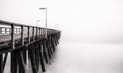 piercing the mist (zzra) Tags: ocean longexposure mono pier high key