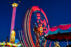 midway lights lll (pbo31) Tags: pleasanton california alamedacounty eastbay bayarea nikon d810 color july 2016 summer boury pbo31 fair 4thjuly spinninglight midway rides lightstream motion motionblur movement red night dark spin spinning shave ice snowcone stand footloose butler amusements vertigo