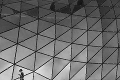 cell phone (james_drury) Tags: street woman abstract reflection glass architecture modern triangles mall shopping mono golden blackwhite phone geometry terraces poland warsaw txt partnership warszawa texting jerde txting tarasy zote explored canonef24105mmf4lisusm