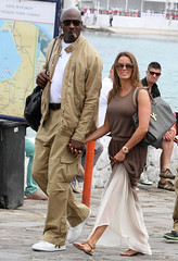 Michael Jordan (Aprokocity) Tags: sunglasses smiling cigar smoking greece wife michaeljordan whiteshirt grc browndress whitesneakers tanpants tanjacket yvetteprieto michaeljordanandyvetteprieto