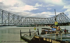 Howrah Bridge - On a Monsoon Day (sandy_photo) Tags: city bridge river cityscape monsoon kolkata calcutta ganga ganges howrah