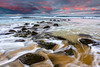 Red Setter (Rodney Campbell) Tags: ocean sunset seascape beach water rocks australia newsouthwales cpl forresters forrestersbeach gnd06
