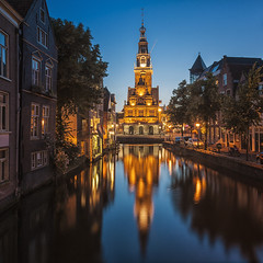Summer Evenings Are The Best (Allard Schager) Tags: street longexposure blue summer holland cars netherlands dutch architecture night reflections gold evening canal nikon cityscape nederland july landmark 11 medieval symmetry illuminated le zomer 10s bluehour autos innercity cinematic alkmaar gettyimages noordholland gracht streetshot canalhouses binnenstad northholland middeleeuws filmisch stadsgezicht weighinghouse waagtoren 2013 touristdestination waaggebouw singleraw fairytalish sprookjesachtig d700 nikond700 luttikoudorp nikonfx allardone allard1 allardschagercom nikkor24mmf35pcetiltshift