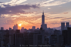 Good Morning Taiwan. (Ollie Smalley Photography (OSP)) Tags: city morning travel blue sky orange sunlight travelling silhouette modern clouds contrast sunrise canon buildings landscape eos early haze construction apartments cityscape rooftops bright air tripod taiwan sunny landmark full flats pollution frame vista getty 5d taipei tall iconic manualfocus ff highrises gettyimages taipeicity osp gapyear travelphotography capitalcity 24105mm canon24105mm rooftopping sirui 5d2 5dii canon5dmarkii olliesmalleyphotography