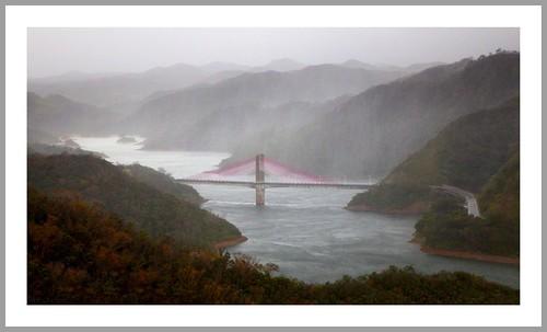 A PASTEL-PINK PYLON BRIDGE CROSSES THE LOST VALLEY OF RAIN
