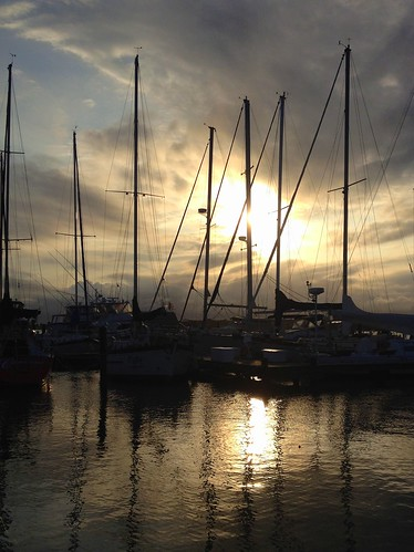 ocean sunset sun reflection beach gulfofmexico colors yellow island gold evening bay texas yacht corpuschristi peaceful sailboats rockport southtexas keyallegro