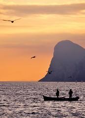 Torbole# (Winter is coming*) Tags: light sunset people italy orange lake nature colors landscapes reflex nikon tramonto earth acqua paesaggi d90 nikond90