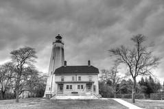 sandy hook B&W (joe.gliozzo) Tags: ocean newyorkcity winter sea usa lighthouse beach water clouds landscape coast newjersey scenery jerseyshore beacon hdr sandyhook sandyhooklighthouse nikond300 josephgliozzo