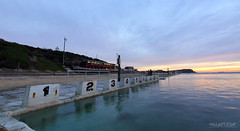 The Center Of Attraction (Andrew Kellaway) Tags: ocean blue sea panorama sun seascape water sport clouds swimming sunrise canon newcastle landscape photography angle wide australia andrew panoramic baths nsw 7d sundance blocks merewether kellaway