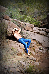 Man relaxing on rocks. (SimsShots Photography) Tags: blue mountains male nude rocks desert jeans barefoot rugged
