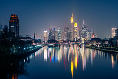City Lights (Philipp Klinger Photography) Tags: longexposure bridge blue sunset sky reflection tower water skyline architecture night skyscraper reflections river germany deutschland long exposure hessen frankfurt main bank hour bluehour deutschebank brcke banks frankfurtammain commerzbank deutsche ffm messeturm mainhattan maintower deutschherrnufer deutschherrnbrcke