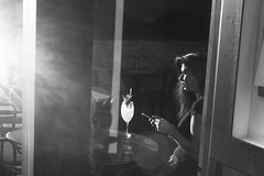 Sunlit (markdavisleica) Tags: street leica urban blackandwhite bw sunlight london girl monochrome bar 35mm glare afternoon shadows candid streetphotography summicron f2 monochrom