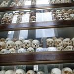 Skulls and Bones of Victims inside Memorial Stupa at Choeung Ek Genocidal Center Phnom Penh thumbnail