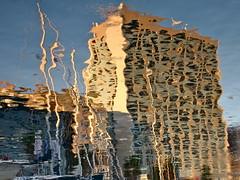 Siria in Vigo (andressolo) Tags: sea distortion reflection building water port docks reflections dark boats boat mar dock agua barco distorted reflected reflect reflejo ripples vigo reflejos distortions