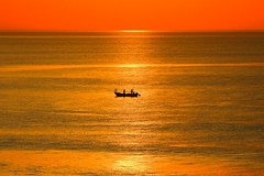 lonely fisherman's boat in a golden sea - Tel-Aviv beach (Lior. L) Tags: sunset sea beach silhouette golden boat telaviv serenity lonely minimalism fishermansboat goldensea