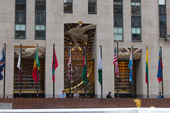 Rockefeller Center (Cthonus) Tags: light geotagged rockefellercenter flags doorway sound wisdom 1933 leelawrie gebuilding rcabuilding raymondhood comcastbuilding radiocorporationofamerica