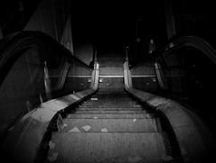 abandoned escalator (Sebastian Schmeinck) Tags: black white bw schwarz weis abandoned escalator dark shadow dunkel stair stufe perspective abstract light point view beginning hell indoor minimal monochrome award awesome