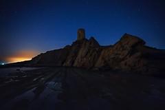 DARK SILHOUETTES (Der_Golem_) Tags: torre playa ruinas verano cadiz nocturna marruecos solitario tarifa 2016 linterna largaexposicion contaminacionluminica guadalmesi