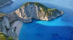 Sun Creep (ott.geoffrey) Tags: blue shadow cliff sun rock island bay ship greece shipwreck zakynthos shipwreckbay