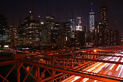 The City That Never Sleeps (stephenb19) Tags: new york city nyc big apple night cityscape cities urban car light trails trail america united states manhattan brooklyn bridge skyscrapers landscape evening glow lights industrial girders architecture