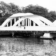 Jumping off Haleiwa Bridge (g1rlwithacurl) Tags: bridge summer blackandwhite water kids hawaii jumping oahu olympus northshore haleiwa omd haleiwabridge