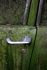 Maverick Door Handle (Samantha Evans of TSI Photography) Tags: door brown black green cars ford texture window lines car metal canon ga silver handle moss rust shine lock decay curves crack vehicles chrome age algae keyhole automobiles doorhandle maverick avacado sps canon50mm oldcarcity fordmaverick whitega canon60d southeasternphotographicsociety
