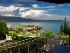 Our holiday residence overlooking beautiful Maderno and Lake Garda (Bn) Tags: blue trees summer vacation italy foothills lake holiday mountains alps west green church water sport swimming fun boats coast harbor town topf50 bars garda mediterranean kayak italia day sailing view apartment cloudy outdoor speedboat restaurants visit spot adventure rowing cypress picturesque topf100 climate pleasure gardameer mild lombardy isoladelgarda toursim maderno 100faves 50faves toscolano maclino residenceilimonidirustichel