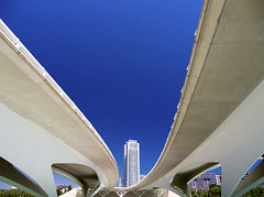 Valencia's Ciudad de las Artes y las Ciensias, Spain - elevated walkways (Jon Bower) Tags: city blue sky geometric glass architecture modern spain arts azure ciudad cloudless artes palau sciences agora concret hemisferic aluminim valenica umbracle modernistic ciensias meseu