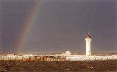 The Storm Abates (Chris Beard - Images) Tags: uk winter sea england lighthouse seascape landscape coast rainbow december newbrighton merseyside stormlight newbrightonlighthouse