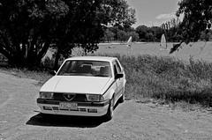Alfa Romeo 75 (NHGE) Tags: auto road cars car photography drive nice automobile driving power wheels engine twin automotive headlights gas alfa romeo brakes petrol autos rims 75 spark fuel drivers horsepower topgear bhp