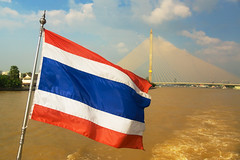 Bangkok - Thai Flag on Chao Phraya River (Kokkai Ng) Tags: travel bridge blue sky