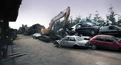 Scrapyard Panorama (Suffolk Makam) Tags: panorama building ford broken junk rust industrial crane decay wheels headlights messy scrapyard scrap derelict vision:mountain=0761 vision:outdoor=0983 vision:sky=0853