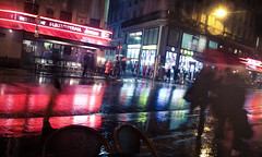Soaking City (speedmatters) Tags: street city urban paris france wet rain weather french colours snapshot grain walkway mobilephone pedestrians colourful moment shopfront soaking nondslr samsungwave