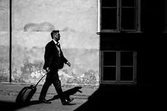 Travelling in black and white (Jan Jespersen) Tags: street city travel urban blackandwhite bw travelling copenhagen denmark citylife streetphotography journey streetphoto traveling suitcase kbenhavn urbanscenes urbanlife urbanscene platea everybodystreet