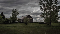 Rural Decay (pooshda) Tags: old house building contrast zeiss dark decay sony ruin eerie haunted sharp 55mm alpha ruraldecay stormclouds rundown westmichigan i196 a7rii