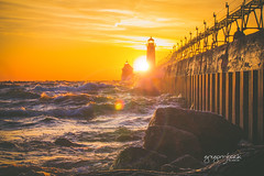 Lighthouse Sunset | Grand Haven, Michigan (gbozik_) Tags: sunset lighthouse lake water canon landscape outside michigan lensflare grandhaven t2i puremichigan